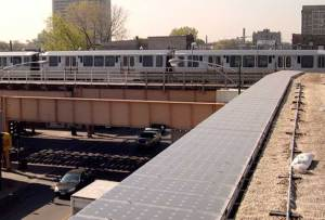 """Rooftop view of """"L"""" train. PV cornice, and just-planted green roof."""